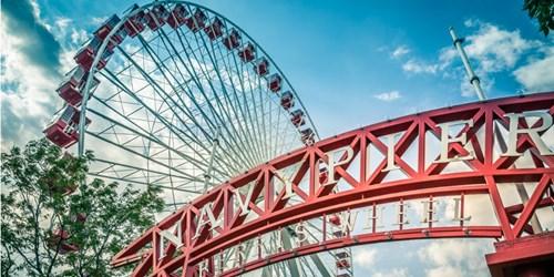 Ferris wheel behind Navy Pier sign